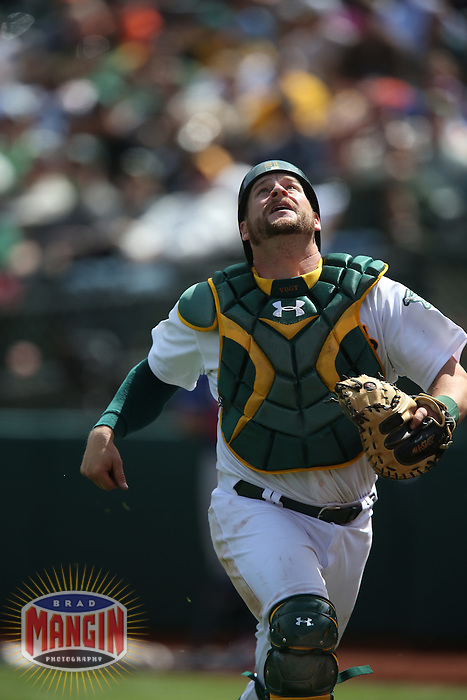 OAKLAND, CA - APRIL 9:  Stephen Vogt #21 of the Oakland Athletics chases a foul ball against the Texas Rangers during the game at O.co Coliseum on Thursday, April 9, 2015 in Oakland, California. Photo by Brad Mangin