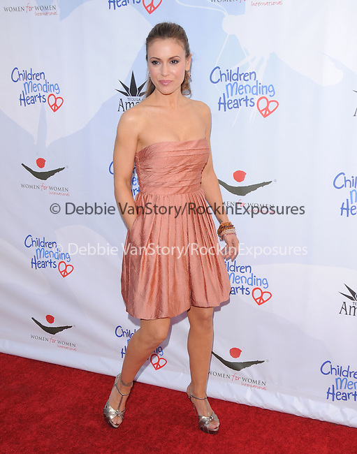 Alyssa Milano at the 3rd annual Children Mending Hearts Peace Please Gala held at  The Music Box @ Henry Fonda Theater in Hollywood, California on April 16,2010                                                                   Copyright 2010  DVS / RockinExposures