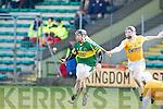 Kerry's John Egan and Antrim's Neill McAuley..