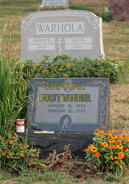 ANDY WARHOL.Grave site at Castle Shannon,.Pittsburgh, 20th July 2005.Artist author.  He gave birth to the Pop Art movement, and his paintings of the Campbell's soup cans brought him to the attention of the art world. Born, raised and schooled in the city of Pittsburgh, Pennsylvania, he was the son of Carpathian immigrant parents from Slovakia. He received his drawing skills and training from Carnegie Institute of Technology, then moved to New York City, gaining success as a commercial artist. He set up a building where he manufactured his art and filmed movies, a place known as The Factory. It was here he came close to death when mentally unbalanced Valerie Solanis came to this location in 1969 and shot him in the chest but he survived. A hereditary gall bladder disease was passed onto Andy Warhol through his father. After complications from bladder surgery at New York Hospital Cornell Medical Center, he died at the age of 58. His body was shipped back to Castle Shannon for burial where a funeral mass was celebrated at St John Baptist Byzantine Catholic Church. A later memorial service was held at St. Patrickís Cathedral attended by over 2,000 people. The Andy Warhol Museum opened in Pittsburgh in 1994, which was the site selected by The Postal Service to issue a 37-cent commemorative stamp in 2002 featuring a self portrait of Andy Warhol. Buried directly behind Andy Warhol are his parents Andrew & Julia Warhola. .www.capitalpictures.com.sales@capitalpictures.com.© Capital Pictures.