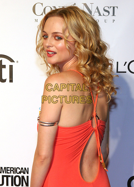 HEATHER GRAHAM.At Fashion Rocks held at Radio City Music Hall,.New Tork, 8th September 2005.half length orange strappy dress silver arm bracelet backless design over shoulder.Ref: ADM/JL.www.capitalpictures.com.sales@capitalpictures.com.© Capital Pictures.