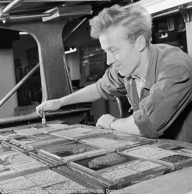 Male print worker working with printing press typeset, Helsinki, Finland, 1957