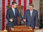 Incoming Speaker of the United States House of Representatives Paul Ryan (Republican of Wisconsin), left, acknowledges the cheers of his colleagues as he is welcomed to the podium by outgoing Speaker John Boehner (Republican of Ohio), right, as Ryan assumes his duties of the office in the US House Chamber in the US Capitol in Washington, DC on Thursday, October 29, 2015.<br /> Credit: Ron Sachs / CNP