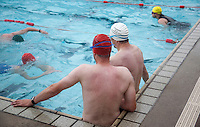 18 JUL 2010 - HATHERSAGE, GBR - Competitors resting between lengths watch their fellow competitors during the Hathersage Hilly Triathlon (PHOTO (C) NIGEL FARROW)