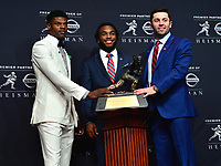 New York, NY - December 9, 2017: The 2017 Heisman Trophy finalists pose with the Heisman Trophy at the New York Marriott Marquis in New York City, December 9, 2017. (L-R) Lamar Jackson (Louisville), Bryce Love (Stanford), Baker Mayfileld (Oklahoma).   (Photo by Don Baxter/Media Images International)