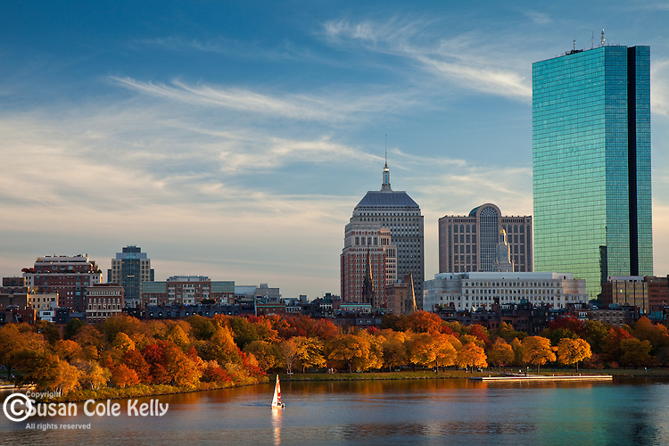 Sailing at sunset under the Back Bay skyline on the Charles River in Boston, MA, USA