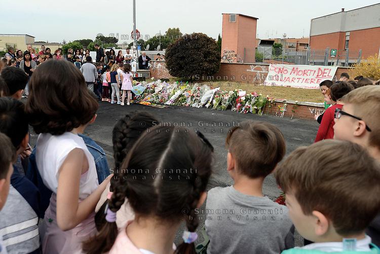 Roma, 12 Maggio 2017<br /> I bambini e le bambine della scuola Iqbal Masih nel quartiere di Centocelle portano fiori, lettere e disegni sul luogo dove le tre sorelle Rom sono state uccise nel Camper dove vivevano.