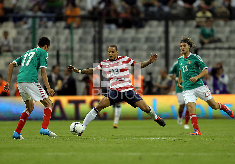 MEXICO CITY, MEXICO - AUGUST 15, 2012:  Jermaine Jones (13) of the USA MNT between Jesus Zavala (17) and Edgar Lugo (23) of  Mexico during an international friendly match at Azteca Stadium, in Mexico City, Mexico on August 15. USA won 1-0.