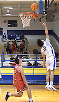 Westside Eagle Observer/MIKE ECKELS<br /> <br /> Christian Ramirez (upper right) bounces the ball off the backboard and into the basket during the fourth quarter of the Decatur-Eureka Springs conference basketball contest at Peterson Gym Jan. 7. The Highlanders took the conference win 45-35 over the Bulldogs.
