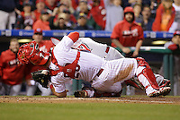 PHILADELPHIA, PA - MAY 14: Cameron Rupp #29 of the Philadelphia Phillies tags out Eugenio Suarez #7 of the Cincinnati Reds during a collision at home plate in the ninth inning during a game at Citizens Bank Park on May 14, 2016 in Philadelphia, Pennsylvania. The Phillies won 4-3. (Photo by Hunter Martin/Getty Images) *** Local Caption *** Cameron Rupp;Eugenio Suarez
