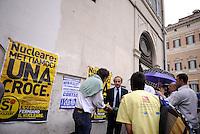 Roma, 24 Maggio 2011.Piazza Montecitorio.Presidio per i Referendum.Al termine del voto di Fiducia l'ex ministro Andrea Ronchi padre della legge sulla privatizzazione dell'acqua e il deputato Adolfo Urso passano nel presidio e vengono contestati.Nella foto Andrea Ronchi