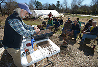 NWA Democrat-Gazette/ANDY SHUPE<br /> Longtime horticulturist Herb Culver of Madison County shows how to plant pepper seeds Saturday, March 3, 2018, during the Starting Your Garden with Herb Culver workshop at Tri Cycle Farms in Fayetteville. Culver, who operated a nursery for 20 years, discussed potting soils, germination, plant care techniques and transplanting.