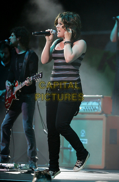 KELLY CLARKSON.performs live on stage at The 10th Annual KIIS FM Wango Tango 2007 held at Verizon Wireless Ampitheatre in Irvine, California, USA, May 12th 2007..full length black and grey striped vest top black jeans  gig concert converse trainers microphone singing.CAP/DVS.©Debbie VanStory/Capital Pictures