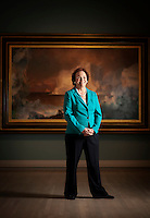 The Eugene McDermott Director of the Dallas Museum of Art Bonnie Pitman (cq) stands in front of The Iceberg, an oil painting by Frederic Edwin Church, at the Dallas Museum of Art in Dallas, Texas, US, Monday, April 26, 2010. ..PHOTO/ MATT NAGER