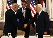 New York, NY - September 22, 2009 -- United States President Barack Obama (C) watches Israeli Prime Minister Benjamin Netanyahu and Palestinian President Mahmoud Abbas (R) shake hands at a trilateral meeting at the Waldorf Astoria Hotel in New York City on Tuesday, September 22, 2009.    .Credit: John Angelillo / Pool via CNP