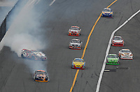 Feb 15, 2007; Daytona, FL, USA; Nascar Nextel Cup Series driver Robby Gordon (7) and A.J. Allmendinger (84) crash during race one of the Gatorade Duel at Daytona International Speedway. Mandatory Credit: Mark J. Rebilas