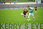 Ballydonoghue's Brian Shanahan gets the ball despite the close attention of Dr. Croake's Aidan O'Shea.
