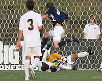 04 September 2009: Jeb Brovsky #5 of the University of Notre Dame leaps over Ike Opara #23 and Akira Fitzgerald #1 of Wake Forest University during an Adidas Soccer Classic match at the University of Indiana in Bloomington, In. The game ended in a 1-1 tie..