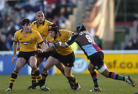 2004/05 Zurich Premiership, NEC Harlequins vs London Wasp,Twickenham, ENGLAND:.Jonny O'Connor, with ball, Wasps player Tom Voyce [left] and and Alister McKenzie - Quins Steve So'oaio moving in to tackle..Photo  Peter Spurrier. .email images@intersport-images.com...