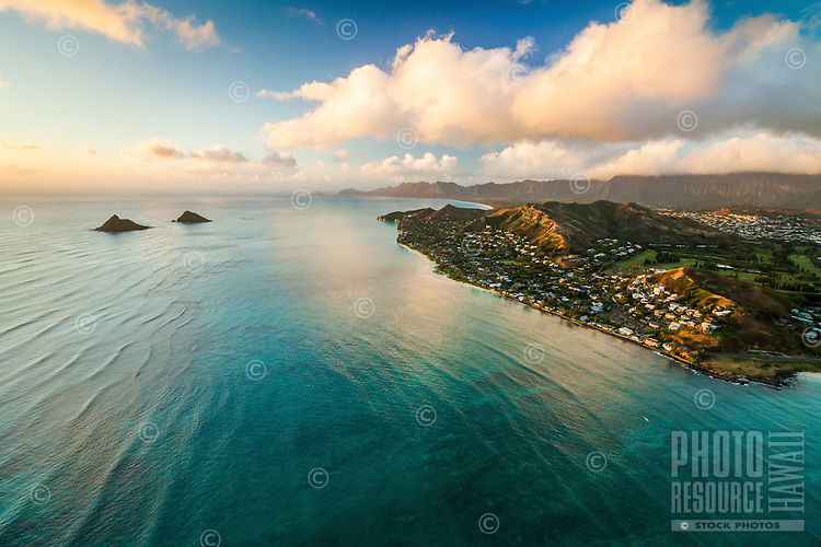 A morning view of Lanikai Beach and neighborhood, with the Mokulua Islets (or Na Mokulua) on the left, Windward O'ahu.