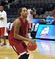 NWA Democrat-Gazette/Michael Woods --03/15/2015--w@NWAMICHAELW... University of Arkansas guard Michael Qualls shoots around Wednesday evening during the Razorbacks practice at Jacksonville Veterans Memorial Arena in Jacksonville, Florida.