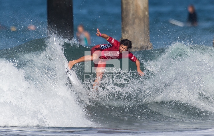 Huntington Beach, CA - Tuesday July 31, 2018: Ian Gouveia in action during a World Surf League (WSL) Qualifying Series (QS) Men's round of 96 heat at the 2018 Vans U.S. Open of Surfing on South side of the Huntington Beach pier.