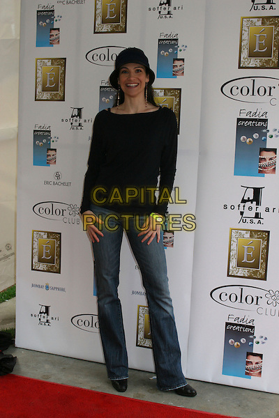 TIMILEE ROMOLINI.2nd Annual Make the Discovery Oscar Retreat,  West Hollywood, California, USA..March 3rd, 2006.Photo: Byron Purvis/AdMedia/Capital Pictures.Ref: BP/ADM.full length jeans denim black top blue hat.www.capitalpictures.com.sales@capitalpictures.com.© Capital Pictures.