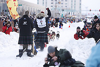 Saturday March 6 , 2010  Wearing a kilt , Wattie McDonald of Scotland leaves the start line during the ceremonial start of the 2010 Iditarod in Anchorage , Alaska