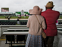 LOUISVILLE, KY - MAY 05: Two fans watch the first race of the day on Kentucky Oaks Day at Churchill Downs on May 5, 2017 in Louisville, Kentucky. (Photo by Douglas DeFelice/Eclipse Sportswire/Getty Images)
