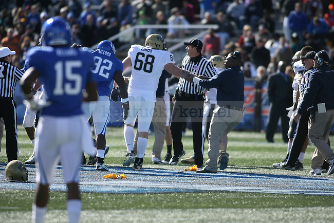 A Pittsburgh coach pulls offensive lineman Jordan Gibbs away after a scuffle between PItt and UK players at Legion Field on Saturday, Jan. 8, 2011. Photo by Scott Hannigan | Staff
