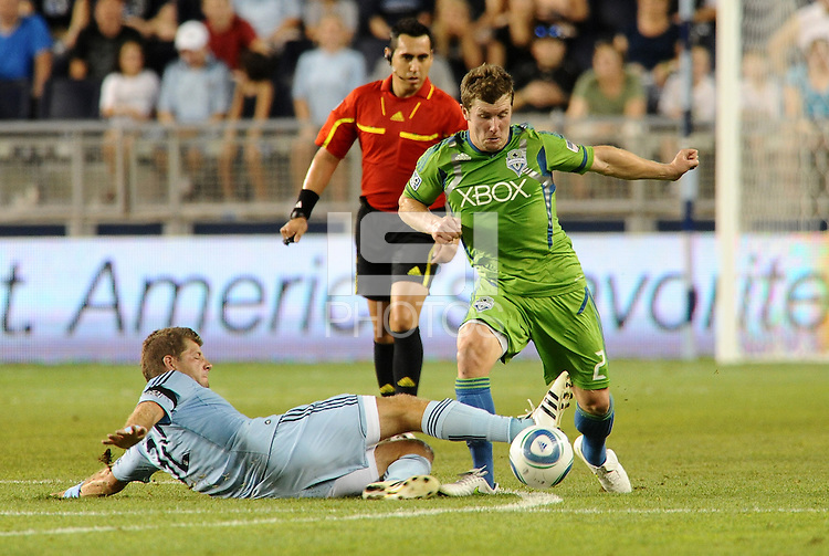 Luke Sassano (32) midfielder Sporting KC on the ground tackles Mike Fucito (2) forward Seattle Sounders... Sporting Kansas City were defeated 1-2 by Seattle Sounders at LIVESTRONG Sporting Park, Kansas City, Kansas.