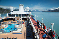 Visitors aboard Pacific Princess Cruise ship Johns Hopkins Inlet and Fairweather mountains in Glacier Bay National Park in Southeast, Alaska   May  2015  No Model Releases<br /> <br /> (C) Jeff Schultz/SchultzPhoto.com