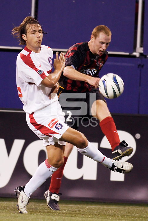 The  MetroStars' Tim Regan  crosses a ball to the middle as the Chicago Fire's Justin Mapp defends. The Chicago Fire played the NY/NJ MetroStars to a one all tie at Giant's Stadium, East Rutherford, NJ, on May 15, 2004.