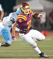 Esperanza's Patrick Campos tries to elude the tackle of Villa Park's<br />