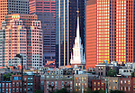 View of the Old North Church steeple against the Financial District skyline at sunrise, Boston, MA, USA