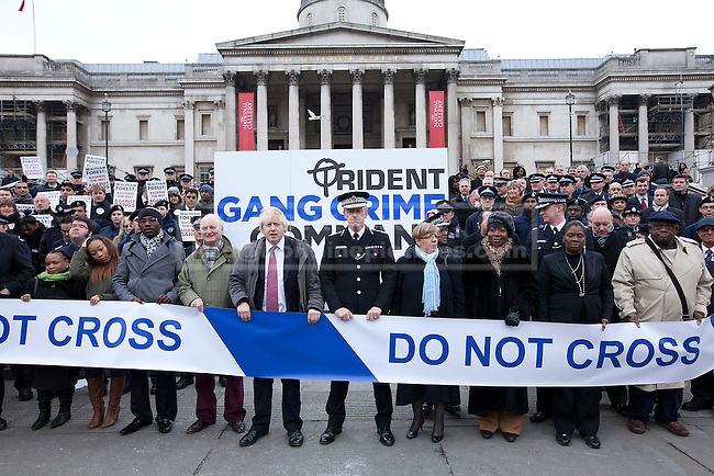 08/02/2012. LONDON, UK. Metropolitan Police Service commissioner Bernard Hogan Howe (centre R) and Mayor of London Boris Johnson (centre L) are seen at an Operation Trident press call at Trafalgar Square in London today (08/02/12). Operation Trident is a Metropolitan Police Service initiative set up to focus on gang and black on black crime in London.