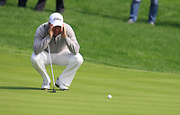 Darren Fichardt (RSA) lines up his putt on the 5th green during Sunday's Final Round of the 2014 BMW Masters held at Lake Malaren, Shanghai, China. 2nd November 2014.<br /> Picture: Eoin Clarke www.golffile.ie