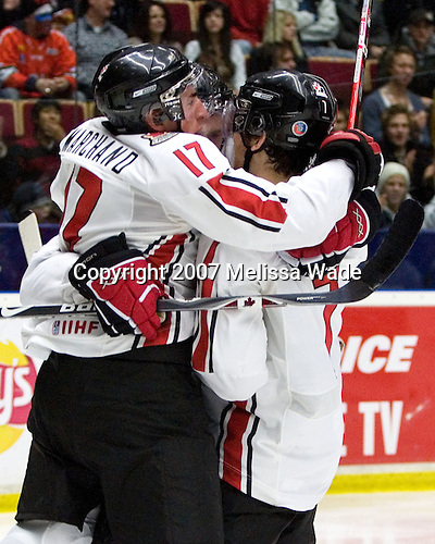 Brad Marchand (Hammonds Plains, NS - Foreurs de Val d'Or), Jonathan Toews (Winnipeg, MB - University of North Dakota Fighting Sioux) and Steve Downie (Queensville, ON - Peterborough Petes) celebrate Marchand's goal. Team Canada defeated Team Russia 4-2 to win the gold medal at the 2007 World Junior Championship at Ejendals Arena in Leksand, Sweden on January 5, 2007.