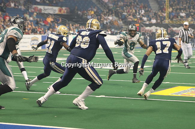 25 June 2010: Battle Wing wide receiver PJ Berry looks for running room.  The Tampa Bay Storm defeated the Bossier-Shreveport Battle Wings 78-39 at the St. Pete Forum in Tampa, Florida