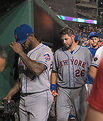 New York Mets shortstop and emergency relief pitcher Jose Reyes (7) and catcher Kevin Plawecki (26) go into the clubhouse following the game against the Washington Nationals at Nationals Park in Washington, D.C. on Tuesday, July 31, 2018.  The Nationals won the game 25 - 4.  Reyes pitched in the eighth inning and gave up six runs<br /> Credit: Ron Sachs / CNP<br /> (RESTRICTION: NO New York or New Jersey Newspapers or newspapers within a 75 mile radius of New York City)