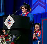 The Rev. Dennis H. Holtschneider, C.M., president of DePaul, listens as Brook Lynn Leonhardt, student speaker, addresses fellow classmates Sunday, June 11, 2017, during the DePaul University College of Science and Health and College of Liberal Arts and Social Sciences commencement ceremony at the Allstate Arena in Rosemont, IL. (DePaul University/Jamie Moncrief)
