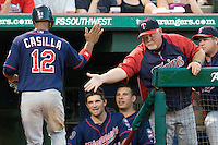 Minnesota Twins manager Ron Gardenhire greets Alexi Casilla after he scored a run during a Major League Baseball game against the Texas Rangers at the Rangers Ballpark in Arlington, Texas on July 27, 2011. Minnesota defeated Texas 7-2.  (Andrew Woolley/Four Seam Images)