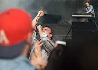 Frontman Samuel T Herring of Future Islands pulls the mic cable as he heads into the crowd during British Summertime Music Festival at Hyde Park, London, England on 18 June 2015. Photo by Andy Rowland.
