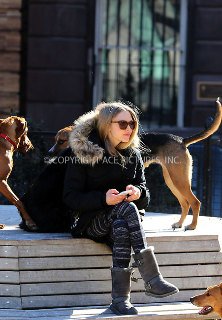 WWW.ACEPIXS.COM<br /> <br /> March 23 2015, New York City<br /> <br /> Actress Amanda Seyfried took her dog Finn to a dog park in the East Village on March 23 2015 in New York City<br /> <br /> By Line: Zelig Shaul/ACE Pictures<br /> <br /> <br /> ACE Pictures, Inc.<br /> tel: 646 769 0430<br /> Email: info@acepixs.com<br /> www.acepixs.com