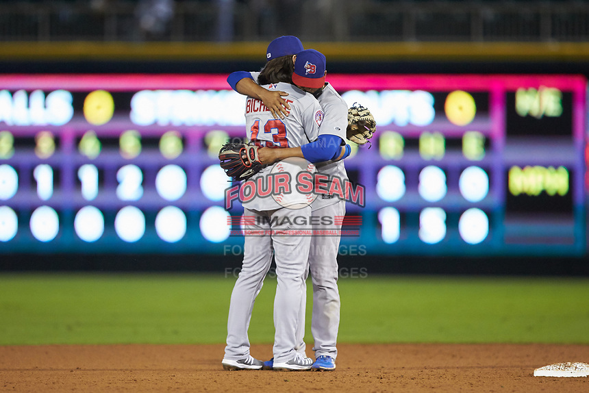Buffalo Bisons shortstop Bo Bichette (13) hugs second baseman Richard Urena (16) following their win over the Caballeros de Charlotte at BB&T BallPark on July 23, 2019 in Charlotte, North Carolina. The Bisons defeated the Caballeros 8-1. (Brian Westerholt/Four Seam Images)