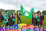 Raising the Green Flag in Scoil Mhic Easmainn on Monday was Minister Jimmy Deenihan. Pictured were staff and pupils: Seamus O'Luasaigh, Ciara de Rath, Tadhg O' hArragáin, Kay de Barra, Treasa Uí Raghaill, Máire Uí Mhurchú, principal Cáit Uí Chonchúir, Barra O' Siochrú, Laoise Ní Dhúlchaointigh, Ciara Ní Ghéaráin, Jimí O'Súilleabáin, Belinda de Gascoine and Jim O'Sullivan.