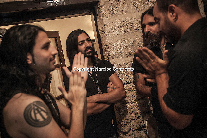 August 27, 2014 - Binyamina, Haifa District, Israel: The musicians at Orphaned Land heavy metal band prepare themselves in the backstage before to perform a concert in Binyamina Amphitheatre at north of Israel. Orphaned Land is a music band founded by Jewish and Arabian musicians who combine ethnic music with rock metal as they recite verses in Hebrew and Arabic from the sacred Quram and Tora Scriptures. (Narciso Contreras/Polaris)