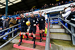 Referee Sebastian Stockridge leads the teams onto the pitch. Oldham v Portsmouth League 1