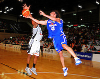 Saints forward Casey Frank tries to lay a shot up past Galen Young. NBL - Wellington Saints v Bay Hawks at TSB Bank Arena, Wellington, New Zealand on Friday, 3 June 2011. Photo: Dave Lintott / lintottphoto.co.nz