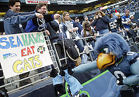 A Seattle Seahawks Fan pumps his holds a stuffed Carolina Panthers doll in the air for Blitz the Seahawks Mascot to punch during the game against the Carolina Panthers at Quest Field in Seattle, WA.